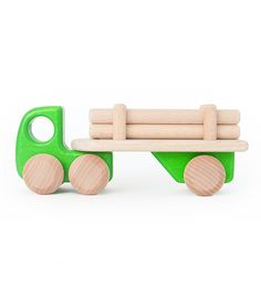 "On the playroom floor or outside in the yard, your child will love playing with this green logging truck! Four wooden ""logs"" can be loaded onto the truck's flatbed - then unloaded for building. Made o"