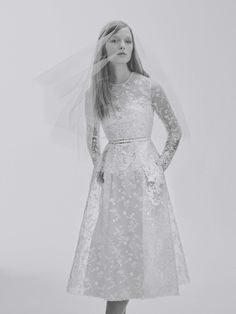 Love the delicate, rich, detailing that converts this humble silhouette to something truly worthy for a bride. The modest veil is such a simple but charming touch. See the complete Elie Saab Bridal Spring 2017 collection.