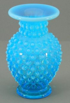 Fenton Blue Glass Opalescent Hobnail Vase Small Bud. $21.99, via Etsy.    I have two of these from my mom, they are precious to me.