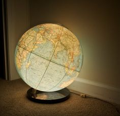 1976 National Geographic World Globe lamp...light up globe with acrylic stand and manuals. on Etsy, $118.00
