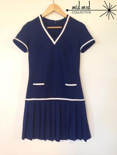 Vintage polyester drop waist sailor dress. Available at Mid Mod Collective.  Email midmodcollective@gmail.com for more info.
