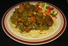 Caribbean Curry Goat #Caribbean #Curry #Goat #Spaghetti #Chickenstock #Carrots #GreenPeas #Okra #Mangoes #ScotchBonnettPeppers #Onions #Garlic #Cucumbers #Tomatoes #GreenOnions