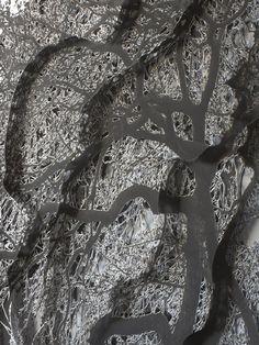 Caroline Jane Harris hand-cuts photographs of trees