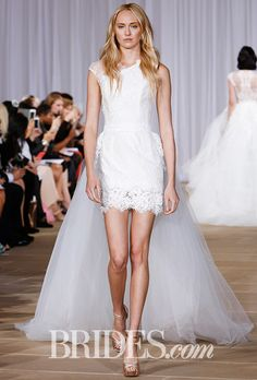 """Brides.com: . """"N16 Vivid"""" asymmetrical sleeveless lace mini with detachable tulle overskirt with scattered lace appliques, Ines Di Santo"""