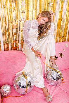 Silk wedding dungarees From the 'Young Hearts, Run Free' 2017 collection by Belle & Bunty, 1970s New York disco scene inspired bridalwear. (Model posed with glitter balls and wearing platform heels).