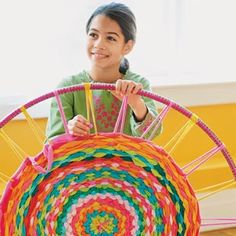 Create A Hula Hoop Rug- good idea for a group/class project. CHildren could dye the fabric first then all contruibute to weaving pieces in.