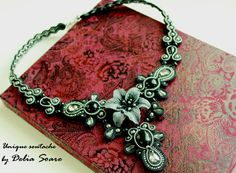 Soutache necklace, with Swarovski cristals and pearls, onix and leather flower. Design by Delia Soare, Romania