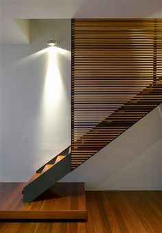 suspended staircase and recycled timber screen