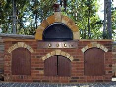 The components of the outdoor pizza oven came from a kit. DIY experts demonstrate how to add the brickwork and sandstone arches to highlight the arched doors and the oven itself.