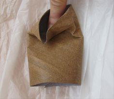 Wet the toilet paper roll, soaking wet Make a crease at the top Paper Mache Clay, Paper Clay, Cardboard Crafts, Paper Crafts, Toilet Paper Roll Art, Ceramic Sculpture Figurative, Origami Envelope, Cardboard Sculpture, How To Make Origami