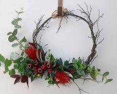 Australian native flower Christmas wreath. Door decoration. Red banksia, gumnut, eucalyptus xmas wreath. Red christmas wall decoration