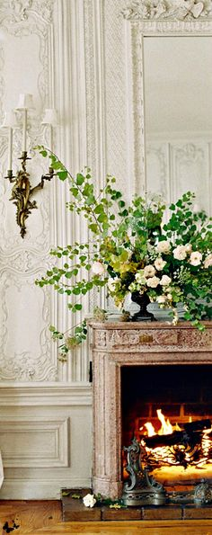 interior design | elegant French plaster and beautiful fireplace mantel and flowers