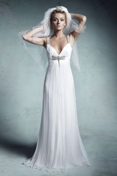 Classic A-line with Art Nouveau embellishments. Timeless beauty with design flair.