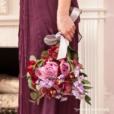 This red and pink bouquet really compliment the dress! photo: www.eyecontact.ca