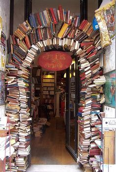 "An arch made of books forms the entryway into the bookshop ""Le Bal des Ardents"" in Lyon, France"