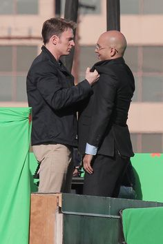 Chris Evans (Steve Rogers) and Maximiliano Hernández (Agent Sitwell) on set of CAPTAIN AMERICA: THE WINTER SOLDIER