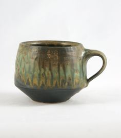 This mug is made of stoneware clay, thrown on a potter's wheel, altered and fired to 2400* in a gas reduction kiln. I see mugs as the most intimate of forms. More than other objects, they have a tendency to become important parts of daily enjoyments. Dimensions: 4H x 3W x 3 D  ********************************************************************  This piece is handmade of Stoneware clay, high fired and durable. Individually thrown on a potters wheel, its form grows from a ball of clay that is…