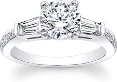 Tapered Baguette Diamond Engagement Ring  : This diamond engagement ring features a tapered baguette on each side of the center stone of your choice as well as round brilliant cut diamonds pave set down the shank.