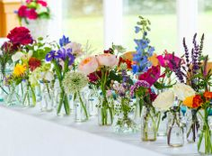 Table runner of vintage inspired bottles and wild flower blooms