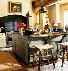 I love this kitchen.  I love the colors, the lights and stools.  This is a perfect kitchen for me.