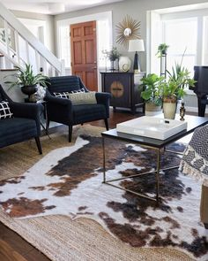 Fall living room with navy blue chairs layered Jute & faux cowhide rug & Target coffee table - Fall Rugs - Ideas of Fall Rugs Fall Living Room, Navy Blue Living Room, Living Room Chairs, Rugs In Living Room, Living Room Designs, Living Room Decor, Living Room Furniture, Target Living Room, Faux Cowhide Rug