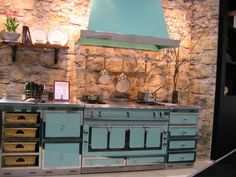 OMG! I need this stove! Anyone know what it is & where I can get one? Is it an Aga?