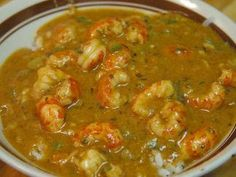 """New Orleans Style Crawfish Étouffée.The term étouffée literally means, """"smothered."""" It is a cooking method of cooking something smothered in a blanket of chopped vegetables over a low flame in a tig Crawfish Tails Recipe, Crawfish Etoufee Recipe, Crawfish Recipes, Crawfish Etouffee, Cajun Recipes, Shrimp Recipes, Gourmet Recipes, Cooking Recipes, Lobster Etouffee Recipe"""