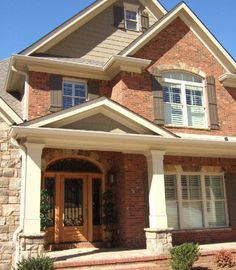 Beautiful Rock Siding for Houses : Traditional Exterior With Brick Rock Siding Combination Orange Brick