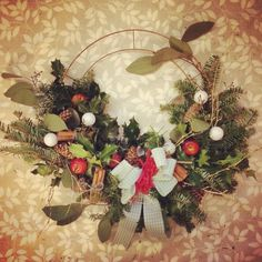 Christmas wreath making 2015. Copper wire base with loose mixed foliage, fircones, cinnamon sticks and baubles. Feeling festive.