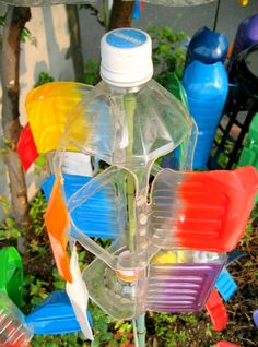 50 million plastic bottles are thrown away each day in the United States. The examples are plentiful, from water bottles to laundry detergent, to how we squeeze out… Continue Reading → Plastic Drink Bottles, Plastic Bottle Crafts, Pet Bottle, Spray Bottle, Water Bottle, Theme Nature, Wind Spinners, Design Your Home, Jewelry Stand