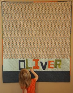 Baby's name on the quilt back! Excellent Idea!