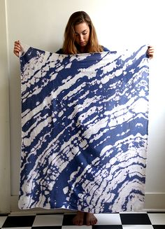 A simple way to create a fun blanket... dunk your cotton/linen into dye!