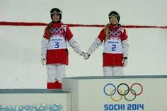 Two Canadian sisters took the gold and silver in the skiing moguls in Sochi - and stepped up to the podium together. Justine Dufour-Lapointe beat her sister Chloe - regarded as the best moguls skier in the world to win the Olympic gold medal. Olympic Gold Medals, All Smiles, Olympics, Ronald Mcdonald, Sisters, Sporty, Celebs, Baseball Cards, T Shirt