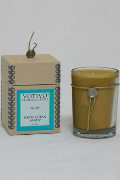 Hand made in the USA using 6.8 oz of highly scented soy wax and a lead-free, cotton wick. Votivo candles have an estimated burn time of 50 hours. Any Votivo candle is sure to fill a room with fragrance. As the warm midsummer day drew to a close, the familiar sea salt freshness awaited their return, but this time was different; a smoke infused woodsy essence rose in gentle swirls from the beach side bonfire beckoning them to enjoy.   White Ocean Sands by Votivo. Home & Gifts - Home Decor…