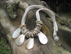 Ada Tear drop shell necklace. $29.95 Gorgeous tear drop shell beads on cream cord. Great for day or evening wear. Length: 46cm Shell Necklaces, Bali, Cord, Shells, Artisan, Beaded Necklace, Cream, How To Wear, Collection
