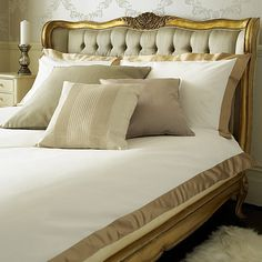 The French Bed Company are truly genius with this Versailles Upholstered Gold toned Bed.