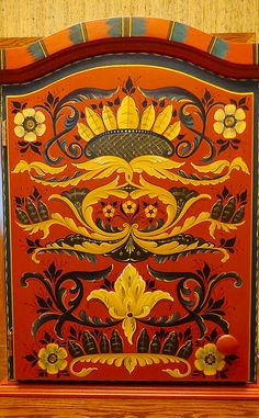 Ken Magnuson used traditional Hallingdal style of rosemaling to paint this cabinet.