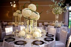 white wedding centerpieces with submerged flowers by Tantawan Bloom