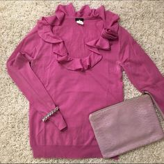 J. Crew lavender sweater w/ ruffled neckline J. Crew lavender sweater with beautiful Ruffles and rose neckline detail. Perfect way to spice up your sweater collection! Slight deodorant stain, easily removable by dry clean. J. Crew Sweaters Crew & Scoop Necks