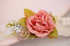 This is a listing for a lace flower headband in champagne, dusty pink and leaf green. Using soft champagne lace, Mademoiselle Artsy created a beautiful flower headband decorated with a dusty pink silk flower, handmade burlap flower, moss and dried babys breath. The back of the flowers are covered with felt to be soft on your princess head. Choose from the following sizes (head circumference): Preemie: 12 (30 cm) Newborn: 13 (35 cm) 1 month: 14 (37 cm) 3 month: 15 (40 cm) 6 months: 17 (43 cm)…