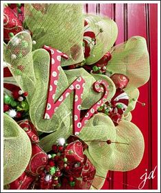 Learn to make a Christmas wreath using mesh ribbon.  Step by step photo tutorial- EASY.