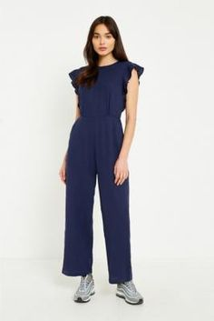 Shop UO Ruffle Sleeve Backless Jumpsuit at Urban Outfitters today. We carry all the latest styles, colours and brands for you to choose from right here.