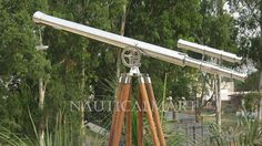 Us Navy Grifith Astro Floor Telescope 40  40 CHROME TELESCOPE ON BEAUTIFUL NATURAL WOOD TRIPOD STAND 60 NICKEL TELESCOPE BY NAUTICALMART FLOOR STANDING ADJUSTABLE TELESCOPE STAND MAGNIFICATION 30X HOT SELLING NAUTICAL DECOR TELESCOPE  NAUTICAL DECOR FLOOR STANDING CHROME GRIFFITH ASTRO TELESCOPE BY NAUTICALMART SIZE; 40 , HEIGHT 64 This is a beautiful solid chrome refractor telescope mounted on a tripod.. A fully functional nautical masterpiece, this telescope makes an excellent gift to the…