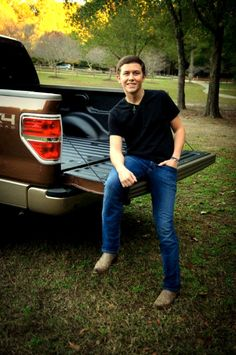 Scotty on the tailgate of his new Ford....I'm in love <3