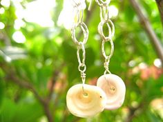 Hawaiian Puka Shell Earrings Shell Earrings Surfer by debbyhawaii. , via Etsy.