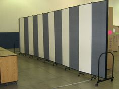 Screenflex portable partitions shown with both fabric and dry erase panels #classroomroomdivider #temporarywall
