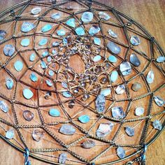 crystals.. dream catcher... woven in... yes, I shall have one of these. I don't know why I never thought of this before.