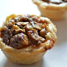 These Pecan Pies might look small.but they pack a BIG Pecan Pie taste! These easy to make mini pecan pies, or pecan tassies are perfect as a holiday dessert. Loaded with chunks of pecan these pies have a wonderful rich flavor. Holiday Desserts, Just Desserts, Holiday Recipes, Delicious Desserts, Yummy Food, Small Desserts, Spring Desserts, Holiday Cookies, Mini Pecan Pies