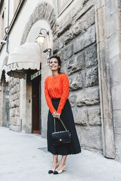 orange sweater + black midi skirt + black Chanel purse + cream and black slingback heels