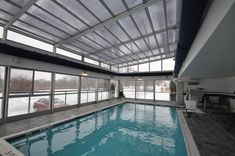 Roll-A-Cover works with many hotel chains to bring them unique retractable enclosure and roof designs allowing for year-round use of their outdoor spaces. Outdoor Swimming Pool, Swimming Pools, Retractable Pool Cover, Automatic Pool Cover, Barcelona Restaurants, Pool Enclosures, Glass Pool, Skylight, Patio